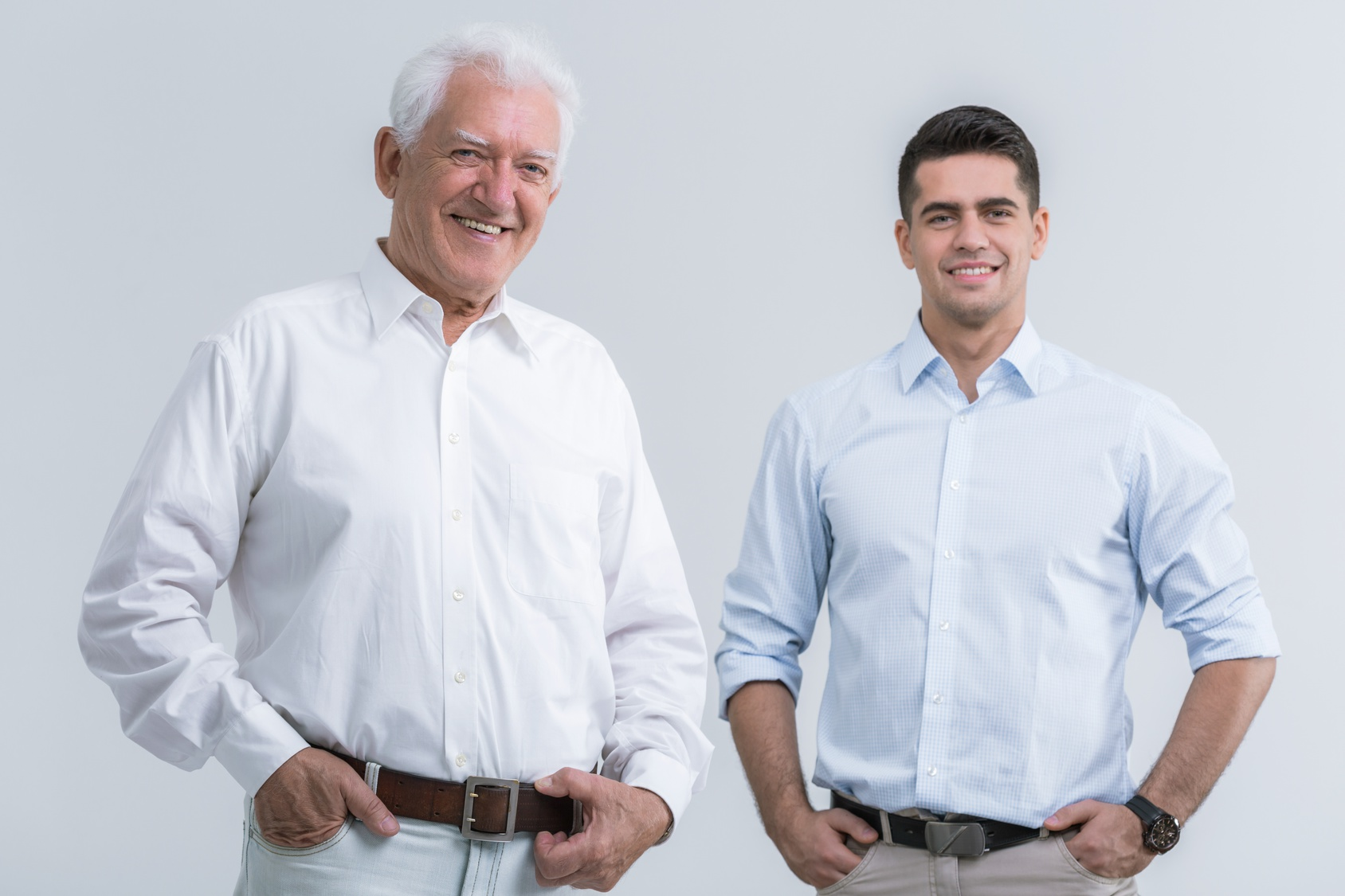 Father with adult son posing to picture